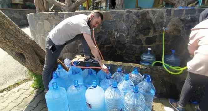 Bursa'da 17 günlük kısıtlama öncesi kaynak suyuna akın var